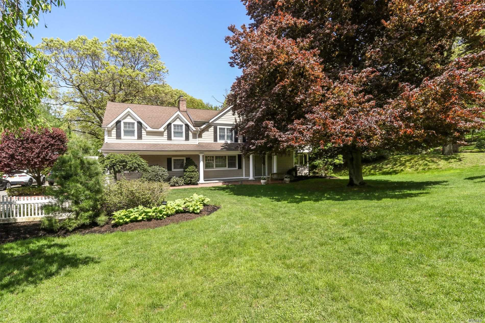 GORGEOUS home in The Gates of Woodbury. This exquisite 7 bedrm colonial is custom built & renovated to perfection. The gourmet Chef's kitchen has every amenity & opens to the XL Dining Rm w/fpl, Den w/fpl, Library w/bar & Living Rm. Entire house is GAS. The 2nd floor has a large Mster Ste w/fpl, balcony, luxury spa bath w/radiant ht + 2 HUGE WIC, in addition to 4 other bedrms & 3 baths + laundry (2 Ensuites). IG pool, paver patio & full house generator. Full bsmt - Syosset SD-- WW Elem/HBT.