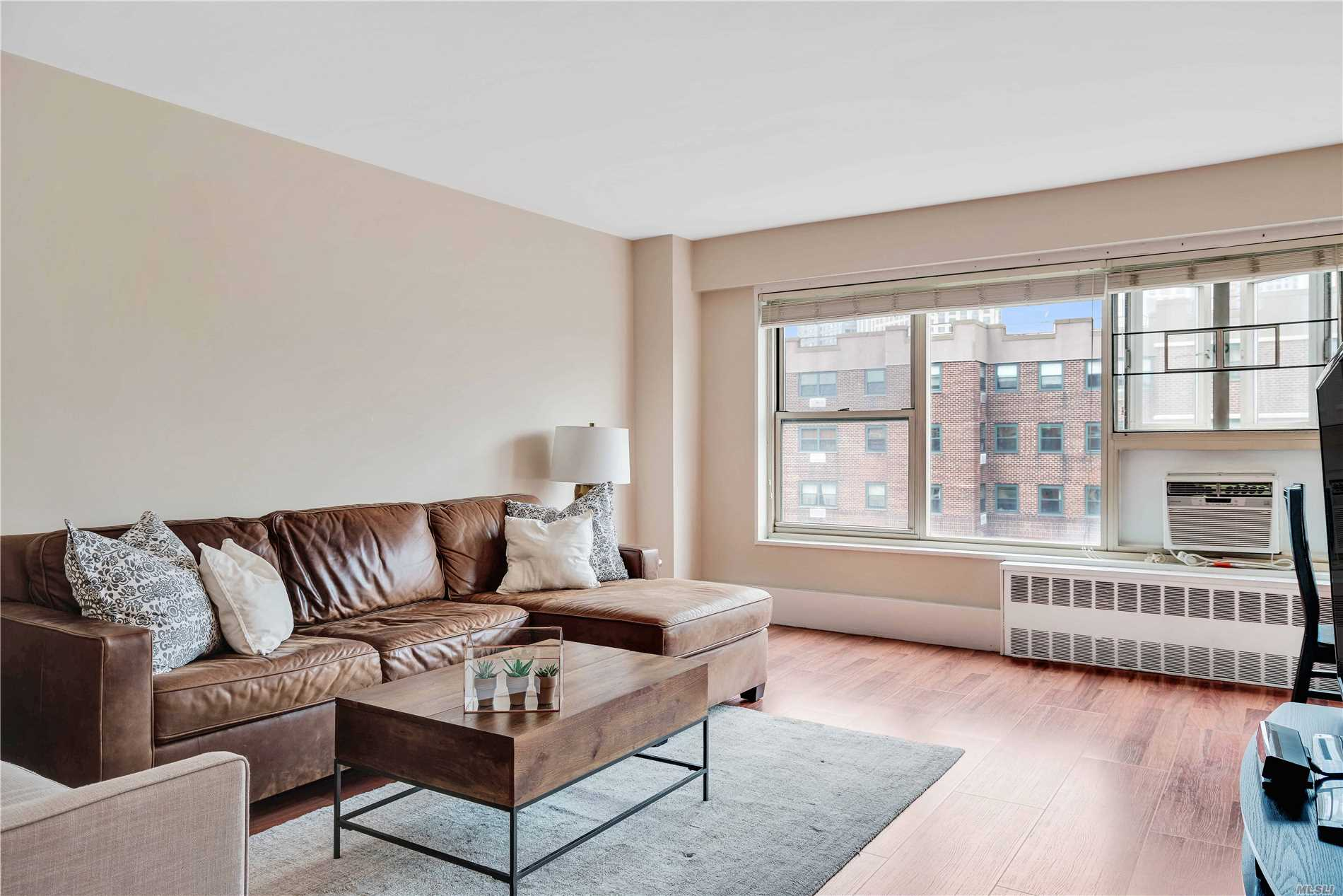 Perched high atop the tree-line with amazing views of the Manhattan Bridge and cityscape, this spacious and artfully laid out 1br co-op unit is yours for the taking! Walking in through the entry, you'll immediately notice the abundance of natural light from the wall of West facing windows. The apartment has plenty of closets for all your storage needs, an L-shaped living room with a dining area, kitchen with SS apliances. Kingsview is a gated community w/ 24hr security guard. Great location!