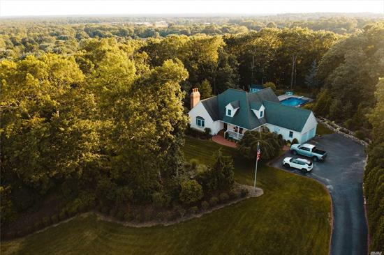 Drone Tour (see link) Impeccably Kept Incredible private shy 2 1/12 acre young 1997 custom built farm ranch country club backyard w/ ig heated salt h2o pool, brick and stone patios. Inside gleaming hardwood floors, cac, cvac, master bd suite with huge wic, great rm for entertaining w/ vaulted ceilings. Recently renovated kitchen with granite & Stainless appliances. Tremendous 2nd floor bonus rm has 1/2 bath, rec. rm and office. Located Gateway to North Fork close to outlets & Wineries.
