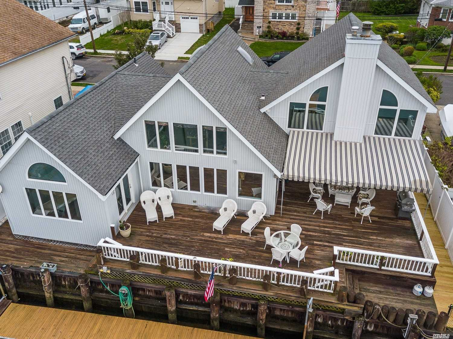 A Boater's Paradise! Luxury Waterfront Home On Deep Water Bay, 4 Mins To Open Bay.4 Bedrm 3 Full Bath w/Many Upgrades. Ground Fl Master Bed Suite w/heated Jacuzzi, Brazilian Hardwood Floors.17'Cultured Stone Fireplace In Vaulted Great Room. Handmade Cabinets , Bosch, Whirlpool, And Sub Zero Appliances 5 Years Old. 1, 000 sq f deck w/custom Awning, 3 Boat Slips. Western Exposure , Breathtaking Sunsets! House Designed To Optimize View In Every Rm.2 Car Atta Garage . Taxes In process Of Being Grieved