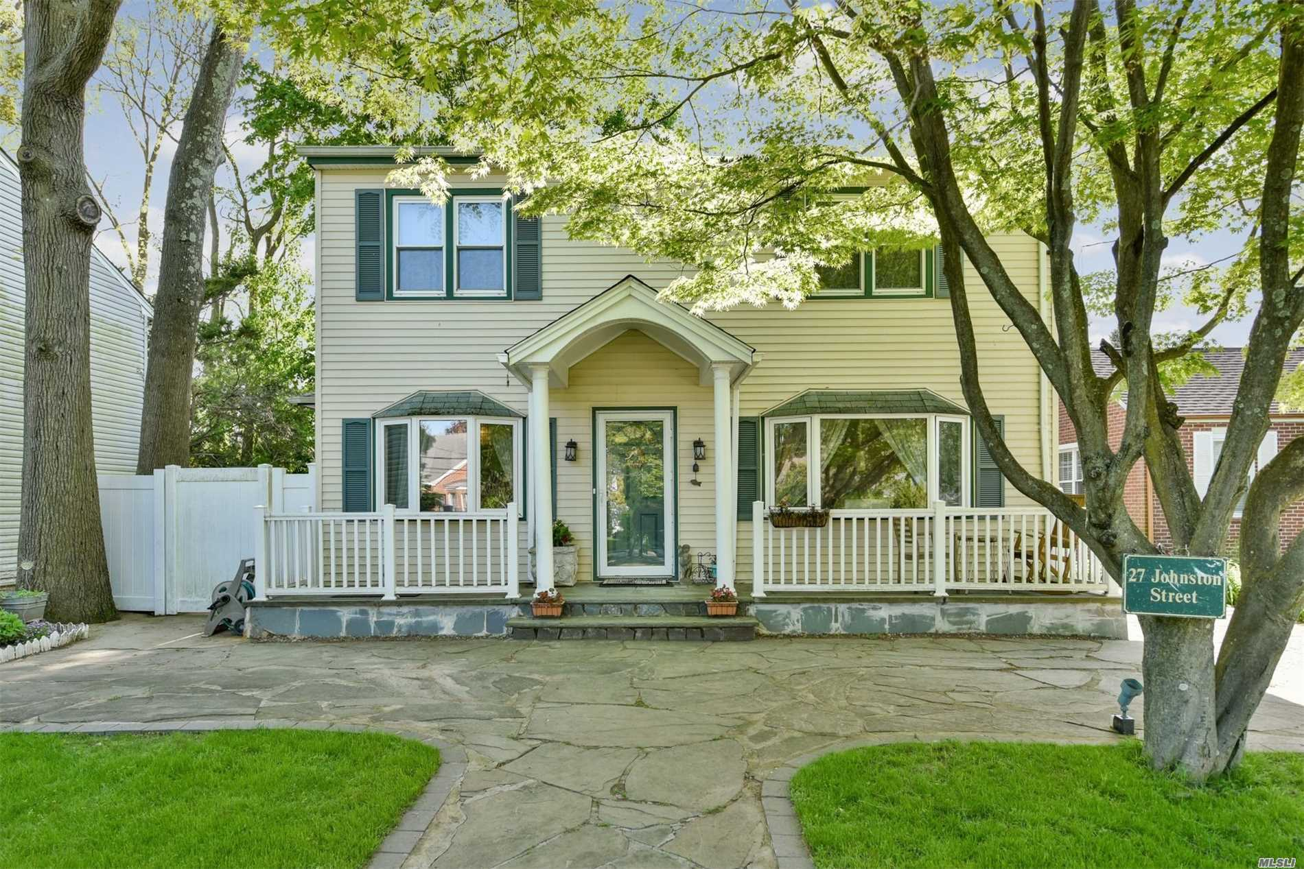 Beautiful Updated Center Hall Colonial Located In Picturesque Locust Valley! Open Floor Plan Features New Full Bath And Eat In Kitchen; Large Living Room With Wood-Burning Stove, Great Entertainment Space, Family Room Overlooking Privately Fenced Yard And Great Closets And Storage!!! There Is A Covered Rear Patio And Separate Shed. Close To Beach, Amusement Park, And Lirr!