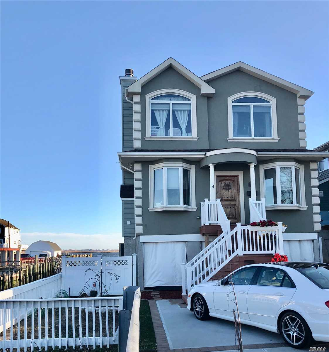 Waterfront FEMA Compliant raised home, totally renovated with hi-end appliances/fixtures/floors/etc... Beautiful Bay View adjacent to beach, pool, tennis/basketball courts, playground & kayak launch area. Tax grievance approved. Awaiting a 13% reduction. Sonos sound system in every room & backyard. Wrap around Trex decking w/Bayview, boat dock & newly refaced bulkhead.