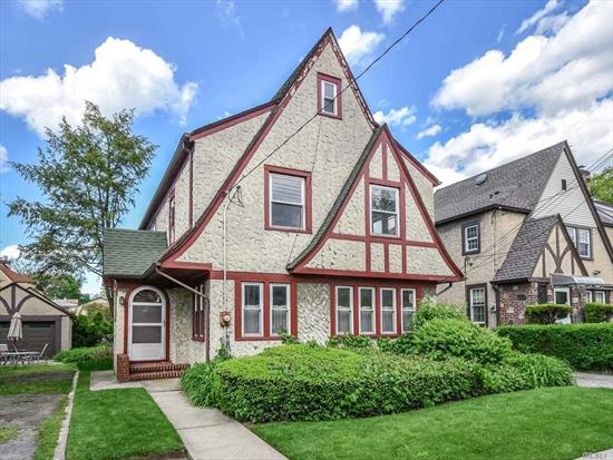 Wonderful opportunity to make this CHARMING, SUNNY tudor your own!!! Lovely room sizes, hardwood floors & wood burning fireplace, new windows and roof, lush landscaping. Private Driveway and One Car Garage. Best of all it is a COMMUTERS DELIGHT a few blocks from the LIRR, Port Washington line and a block from restaurants, shopping & school! The home is being sold as is. Don't let this one pass you by!!