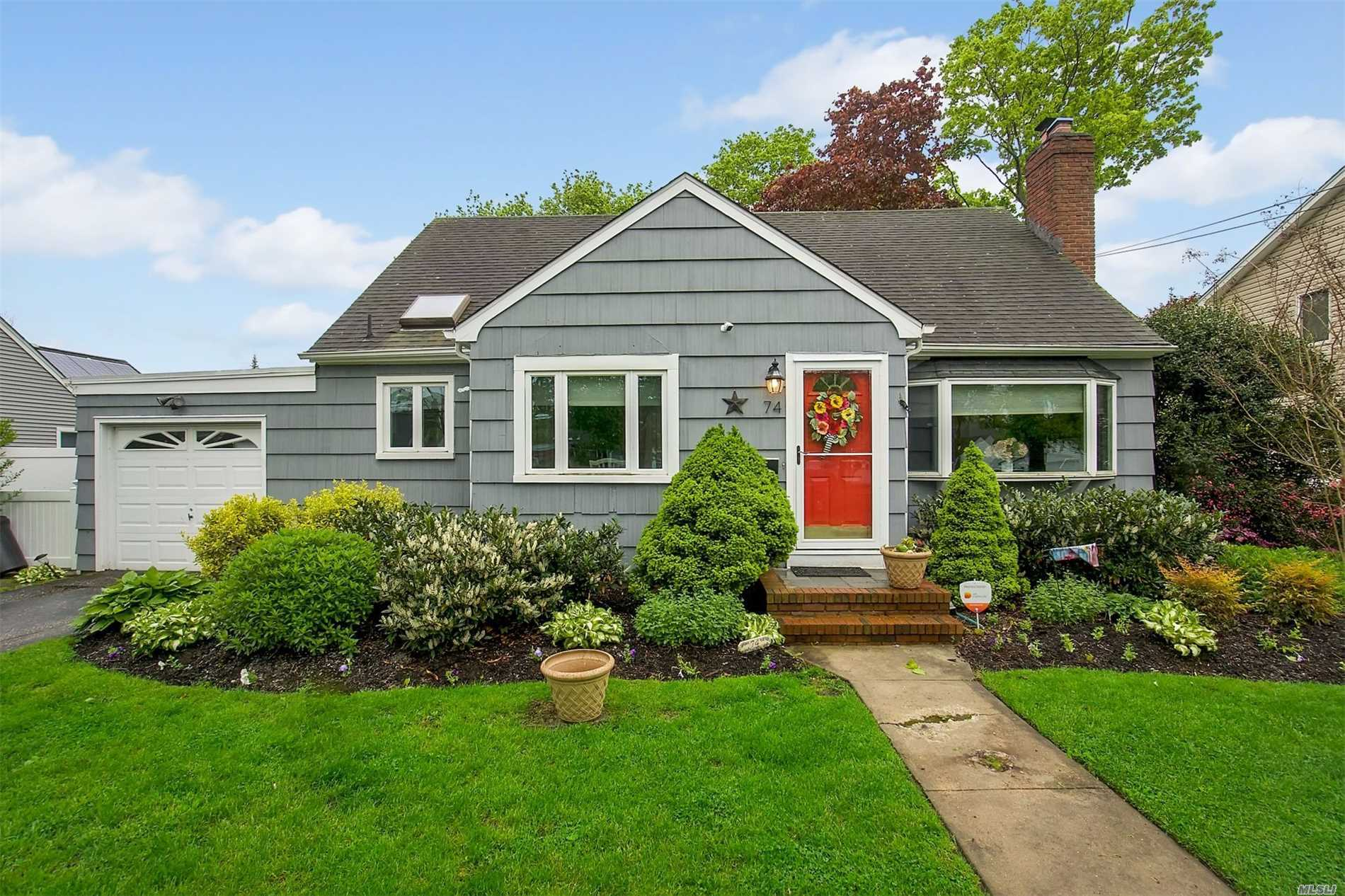 Come See This Lovely Expanded Cape with a Formal Living Rm w/Wood Burning Fireplace, Formal Dining Rm, Eat In Kitchen, Den Or Bedroom, Master Bedroom, Full Bath - 2nd Floor has Additional Bedrooms, Full Bath & Storage - There are Hardwood Floors Throughout and this home has many updates including Kitchen, Appliances, Bathrooms, Central Air, 200 Amp Electric Full Basement, 1 Car Garage - Don't Miss This One!!