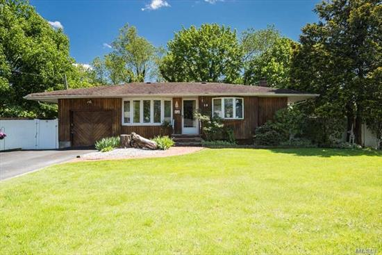 Large Ranch with Full Finished Basement Features Hardwood Floors throughout,  3 Bedrooms, Large Living Room, Den and Eat in Kitchen & a huge wrap around Deck in backyard