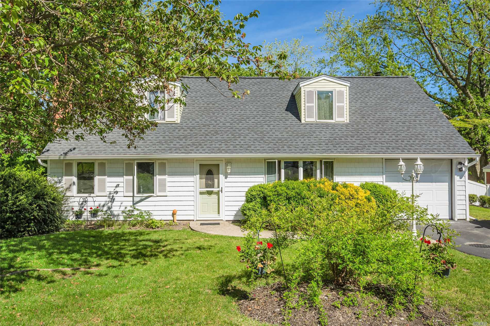 This 4 bedroom 2 bath cape offers a new roof, boiler and water tank are 5 years old. Relax by the fire or on your patio in the yard. Close to the LIE and train.