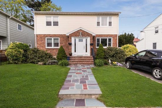 Legal 2-fam. w/a fenced yard in desirable Manorhaven Village. Stunning 1st flr has hdwd flrs, large living rm. Ample stor. in this modern EIK w/granite cntp, s/s appl & subway-tiled bkspl. 2 bdrms, pristine full bth. Upstrs unit has spacious living rm. w/sunny oversized kit w/dining area, 2 bdrms & full bth. LL has lrg rec room w/space for offc, playroom, full bth, stor/util. Separate meters, 2 burners, Ose. Close to rest, schls, shop, LIRR. Low taxes.