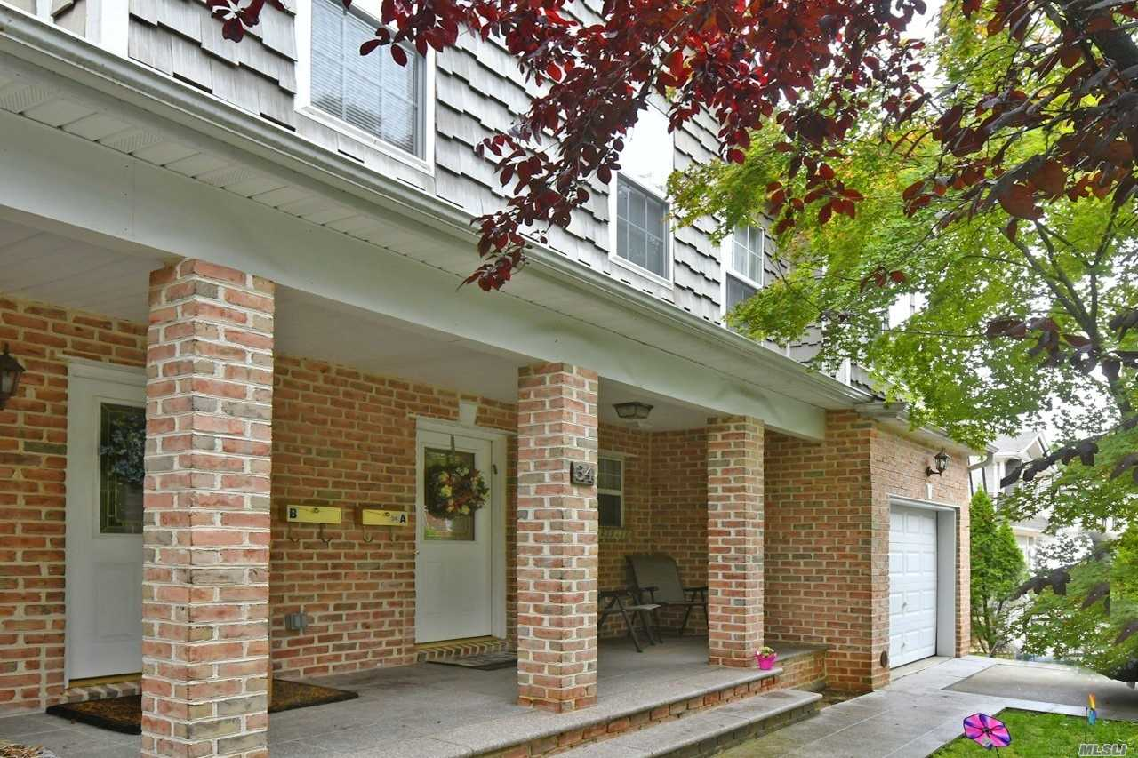 Mint condition Duplex offers 4 bedrooms includes Master suite/vault ceiling/walk-in closet, enormous eat-in-kitchen w/stainless steel appliances, large living room and formal dining room with gas fireplace,  additional 3 over-sized bedrooms, 8.5 ceiling finished basement, attached 1 car garage plus driveway parking space. Community park, pool, tennis and play ground. LIRR 35 minutes to NYC.