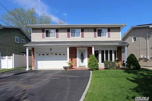 Bellmore Beauty... Spacious Colonial Splanch at the end of a quiet block. This oversized home has the room you have been looking for. Hardwood floors throughout. Large EIKitchen, Formal Dining Room and Spacious Family Room with sliders to a large oversized back yard; Gazebo included. Formal Den looking into your back yard and 3 Bedrooms and a Master Suite on top floor. 2 car garage. Walking path to LIRR.