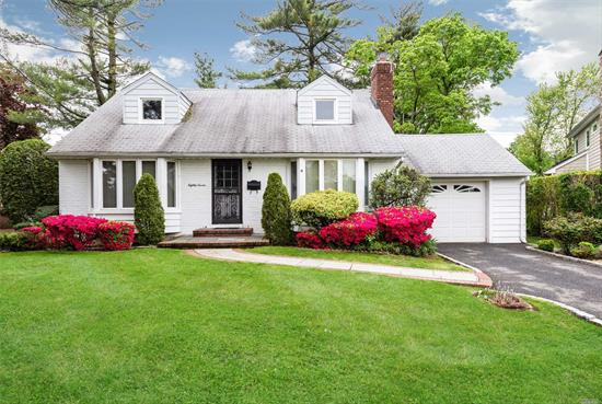 A extended wideline cape in the East Williston schools, living room with fireplace, huge dining room, kitchen, den, laundry, 4 bedrooms, 2 full bath, huge garage with high ceilings, all hardwood floors, basement, the yard has an easement please see survey-large yard.