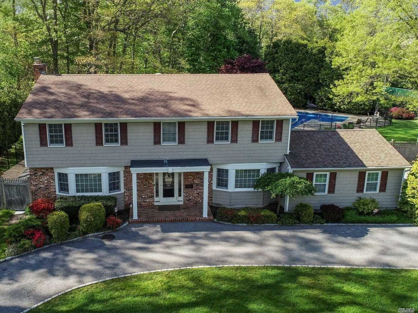 Resort Living at its finest!!! Enjoy Country Club living in your own fully fenced, 1+ acre grounds w/ Built in BBQ, Salt water pool w/ waterfall, Cabana house, Brick patios, dog run, surround sound, lush lawns &specimen plantings. This Spacious, 4 Bedroom, 2.5 bath home has been totally designer renovated. Enjoy radiant heated floors, Chef's kitchen w/ Plato Cabinetry, Custom built ins, Gas heat and Fireplace, 2019 CAC, New baths, Anderson windows, Tons of storage, Custom Garage, Cul-de-Sac, Low Taxes!