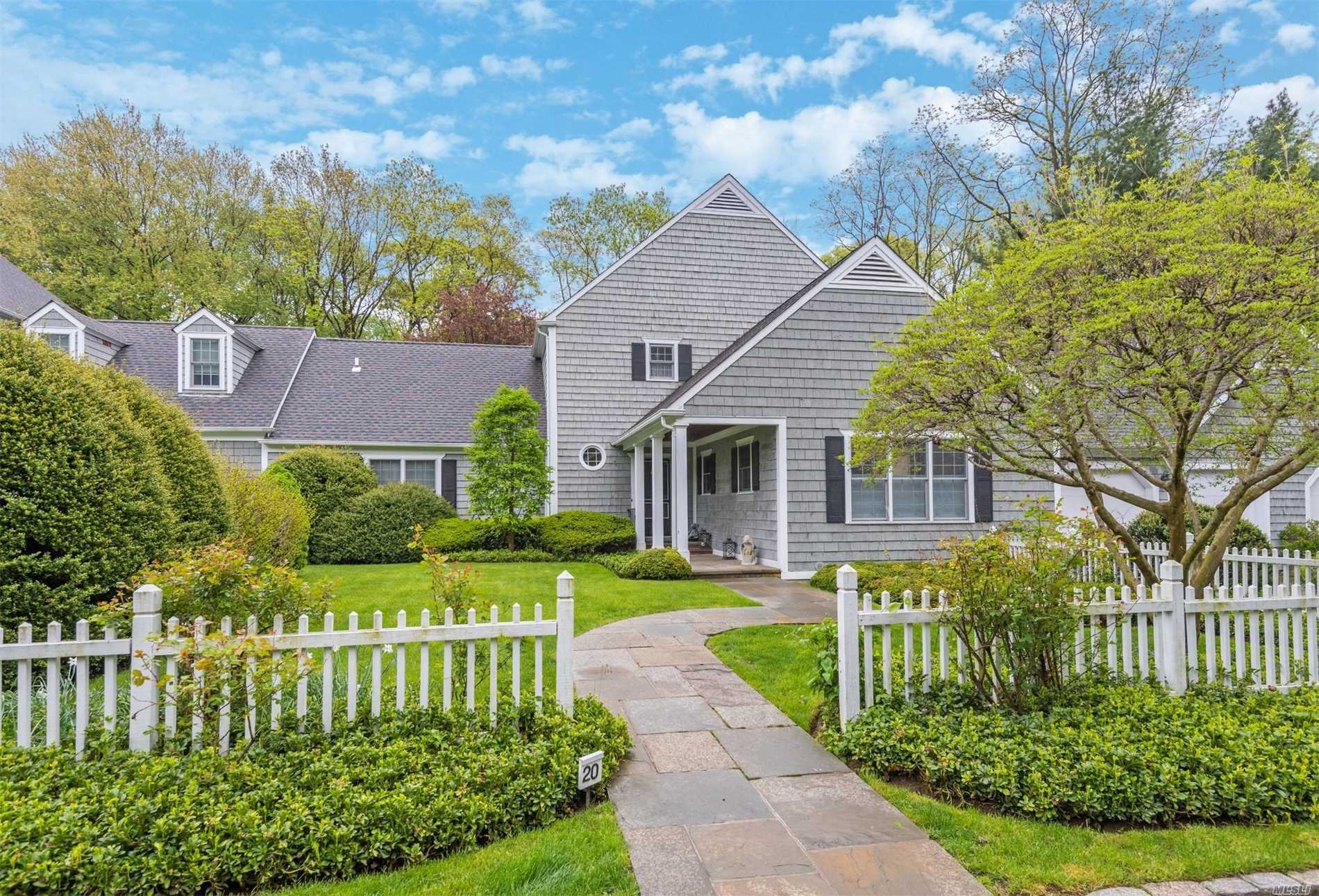 Renovated Nantucket style home with formal gardens, backing a preserve offering a serene and quiet setting. A gracious entrance and elegant entertaining rooms all overlooking wonderful gardens. Features include a new Gourmet Kitchen with walls of cabinetry, center island, calcutta marble countertop & top of the line appliances, service bar area to match, 2 Master Ensuite Bedrooms with new baths & spacious outfitted closets, 20 Kw Generator, 2013 Hot H20 Htr & Furnace, Updated roof, HOA
