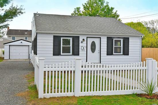 Newly renovated Cape located in Brightwaters Farm with Open concept layout. Gorgeous Contemporary Kitchen with SS appliances and quartz countertops. Private Fully fenced Yard with Paver Patio. Also has a Large 1 1/2 car garage. New sprinkler system. Plenty of storage. Low Taxes -- $6543.56 with STAR Rebate.