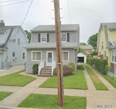 Great Location, Mid-Block, Close To City Buses, Parkways, Schools, Stores, Restaurants, And LIRR. Very Nice Backyard, Very Low Taxes!! Location, Location, Location!!!