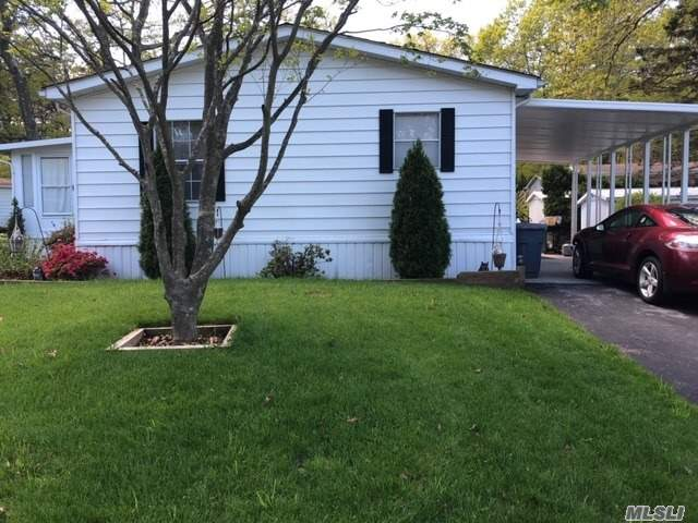 Many updates. Double wide, carport, sunroom, wood planking throughout, newer fridge and oven. Pergo flooring, igs., newer washer and dryer. $982.00 for lot rent
