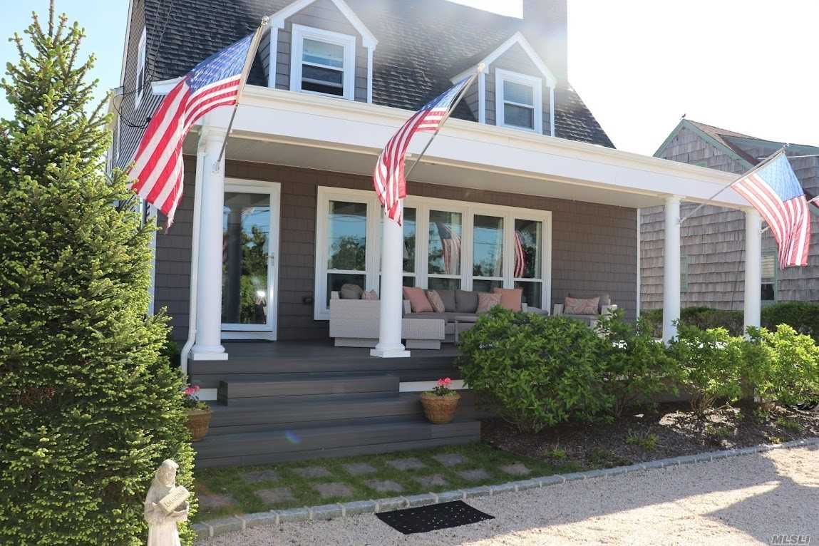 Beautiful Cottage Style Home sitting on .56 acres on sought after Bay Side of Asharoken. Stunning Views of Northport Harbor and Duck Island along with your own Private Beach directly on the Long Island Sound in front of home. Enjoy unobstructed views of the Sound and Coastal Connecticut from the lovely updated porch This Waterfront Opportunity has been elegantly updated with large windows, new roof and siding, new gourmet kitchen, high end finishes.You will not be disappointed!