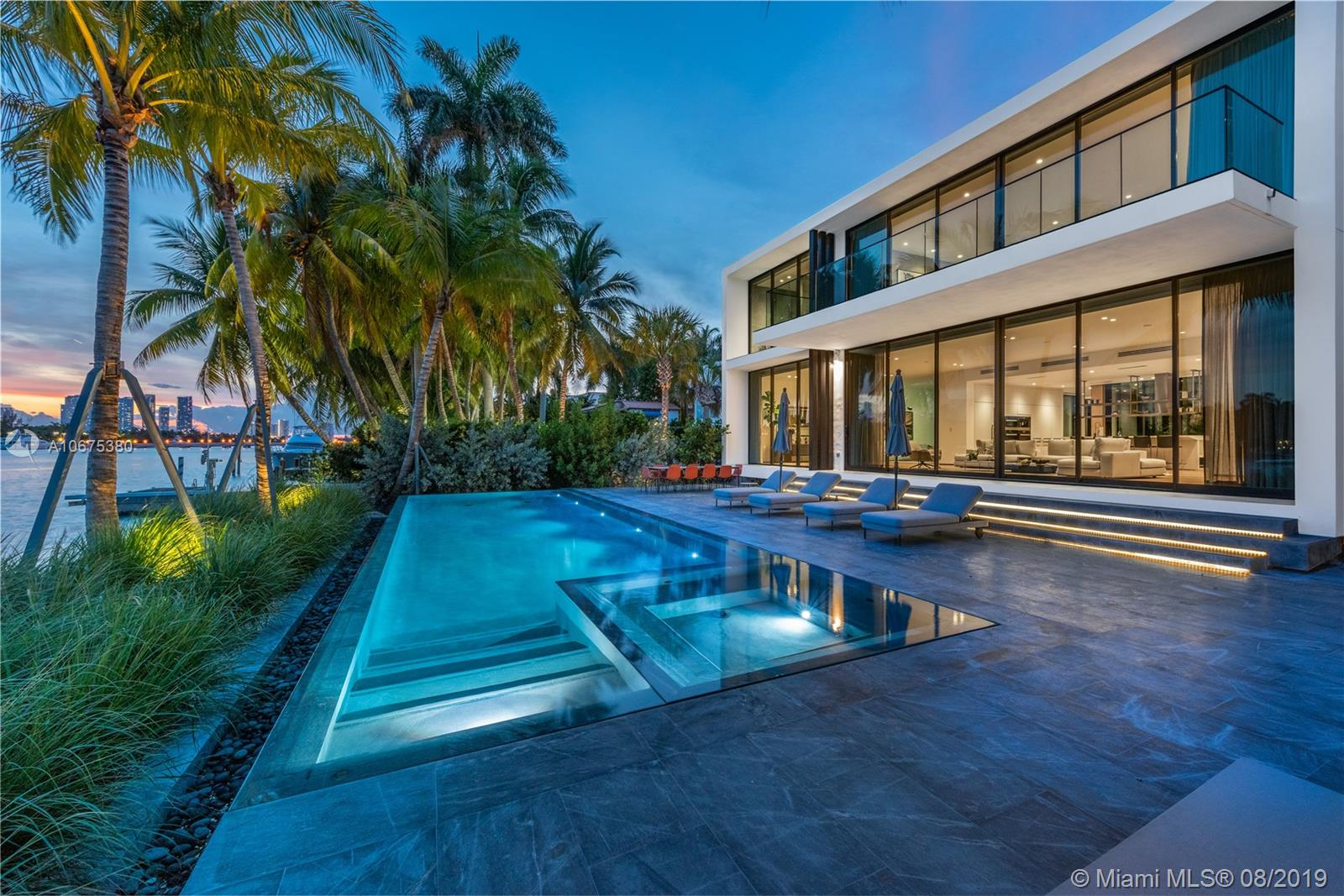 New Modern, Uniquely Designed Elevated +Ógé¼+Ôglass+Ógé¼ House On Gated And Secured Hibiscus Island. Southern Exposure, Panoramic Views Of Biscayne Bay And Downtown. Private Entry Garden Capturing Sea Breeze With An Open Floor Plan With Tall 20+Ógé¼Gäó Ceiling Entry Leading To Glassed Central Courtyard Adding Natural Light And Enhancing Views. Spacious Master Suite, Captivating Scenes And Oversized Terrace.Rare Separate Guest House With Full Kitchen And 2 Car Garage.Custom Furniture Professionally Decorated Throughout. Sleek Pool With Concealed Equipment And Infinity Edge, Outdoor Kitchen And Custom Outdoor Seating. Elevator Leading To Private Rooftop Terrace. Island Amenities Include Tennis Basketball, Playground, Newly Paved Streets, New Utilities, New Landscaping And Police Protection.