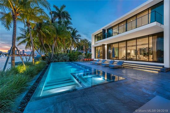 New Modern, Uniquely Designed Elevated Glass House On Gated And Secured Hibiscus Island. Southern Exposure, Panoramic Views Of Biscayne Bay And Downtown. Private Entry Garden Capturing Sea Breeze With An Open Floor Plan With Tall 20' Ceiling Entry Leading To Glassed Central Courtyard Adding Natural Light And Enhancing Views. Spacious Master Suite, Captivating Scenes And Oversized Terrace.Rare Separate Guest House With Full Kitchen And 2 Car Garage.Custom Furniture Professionally Decorated Throughout. Sleek Pool With Concealed Equipment And Infinity Edge, Outdoor Kitchen And Custom Outdoor Seating. Elevator Leading To Private Rooftop Terrace. Island Amenities Include Tennis Basketball, Playground, Newly Paved Streets, New Utilities, New Landscaping And Police Protection.