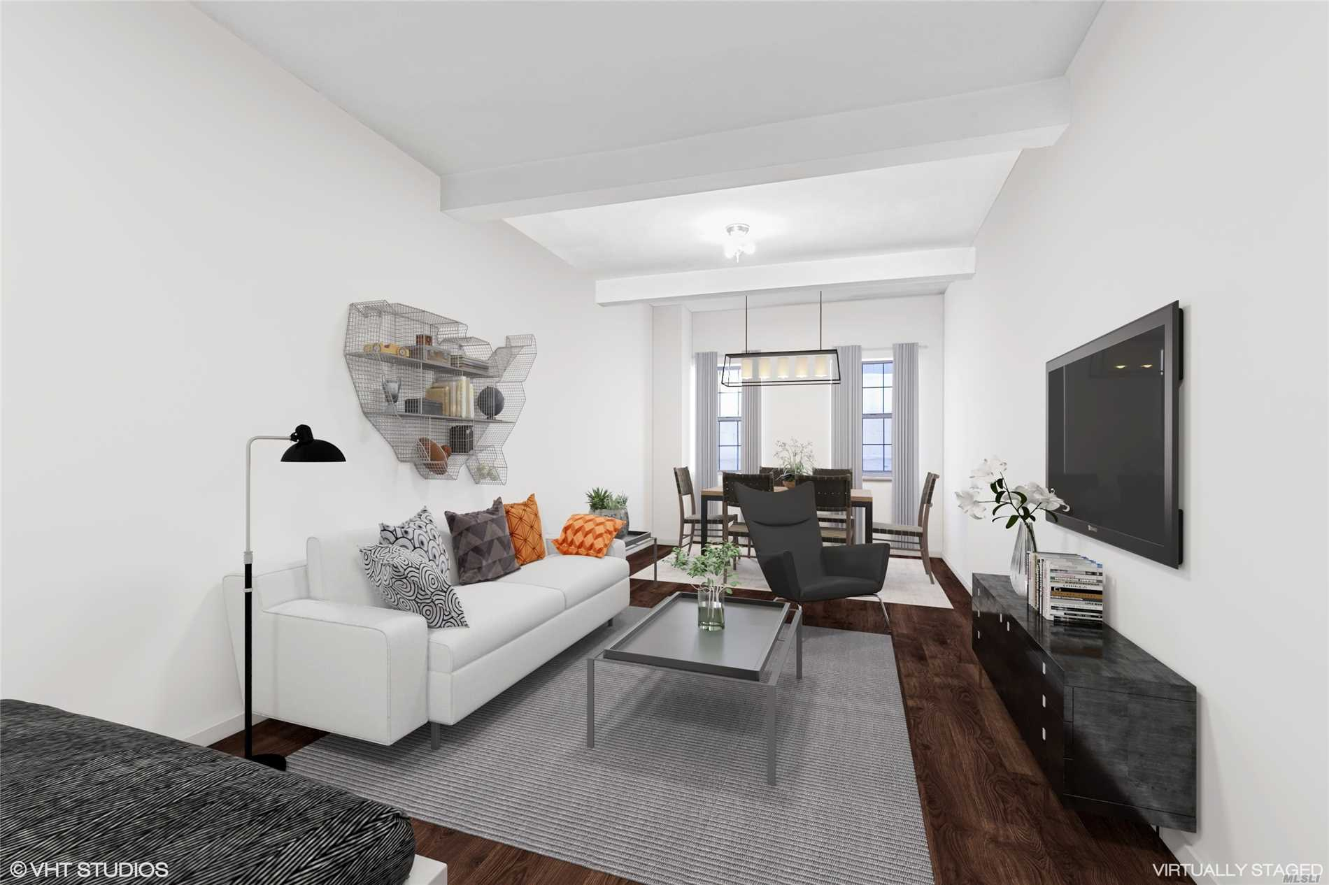 Industrial Chic, ground level HUGE studio, amazing living space!. CRAZY LOW MAINTENANCE! Needs TLC, priced right! Windowed eat-in kitchen and windowed bath. Just a half block to train and shopping. Express bus to NYC two blocks.
