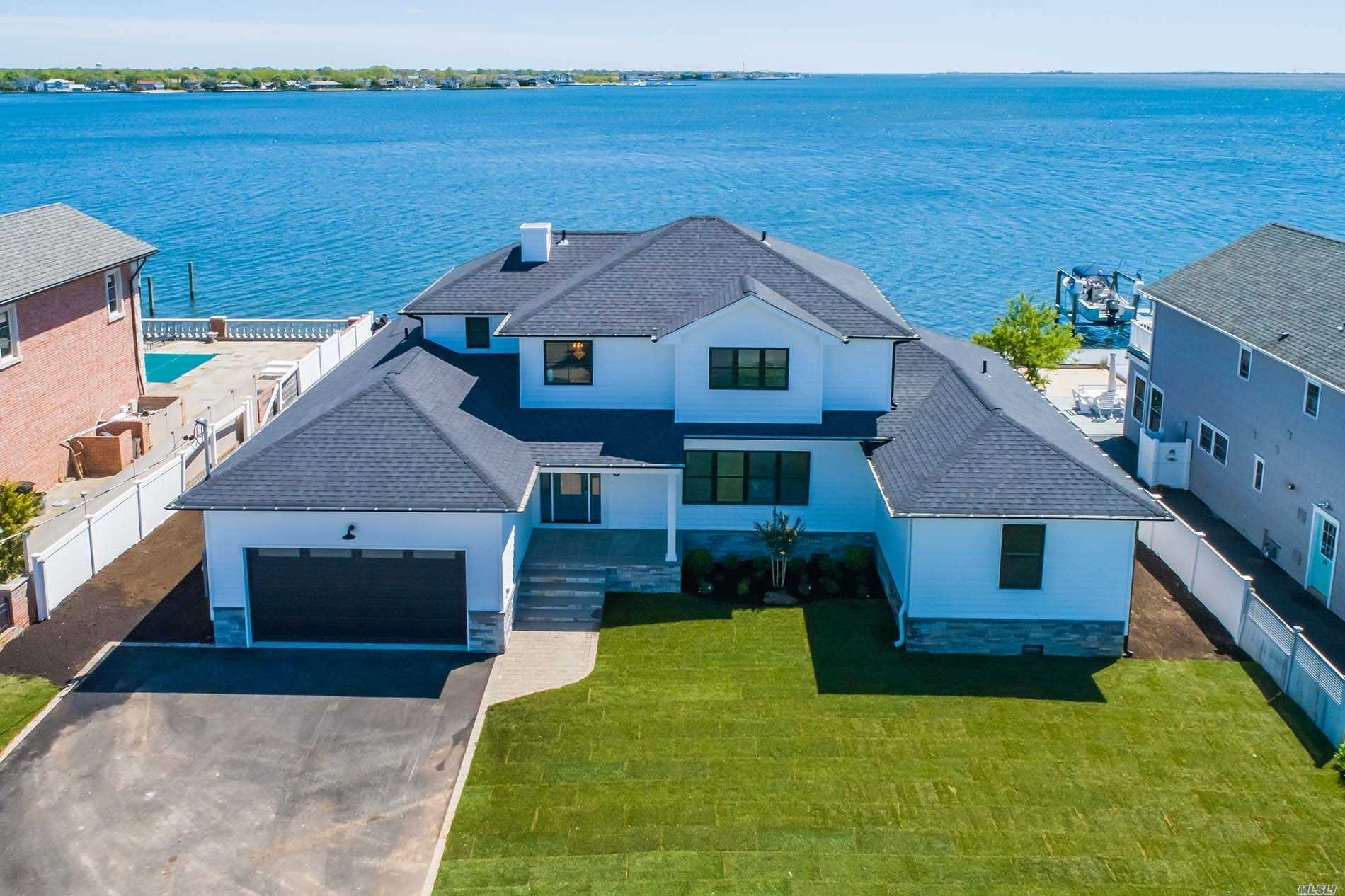 One Of A Kind, New Construction True Bayfront Home On A Huge Property Deep In The Beautiful Nassau Shores Community! Custom Designed Home Features An Open Layout, High-End Designer EIK Kitchen, Open Large Lr & Dr, Family Rm W/Frplc, Exquisite Master Suite W/Fbath-W/I Closet, 3 Add Bedrms(2 Downstrs), 3.5 Baths, wall-to-wall sliders to deck!!2 car garage. Top Quality Workmanship!.Built High Elevation.Stunning Bay Views From Every Room!New Construction Bayfront, Wow!!!