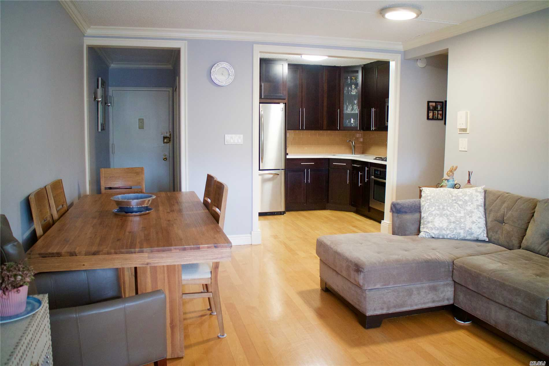 Beautifully renovated and exquisitely kept 2 bedrm, 1.5 bathrm condo in Middle Village North with an indoor parking spot + balcony Bright & sunny apt features Oak wood floors, crown molding marble countertop, custom cabinets, SS appliances, & many more upgrades. Zoned for PS 128.. Ideally located blocks to Juniper Valley Park, .3 mile to M train, Q54 & Q38 buses. *** Current tax abatement: taxes are discounted $1, 122.00 a year for primary residents, needs to reapply yearly.