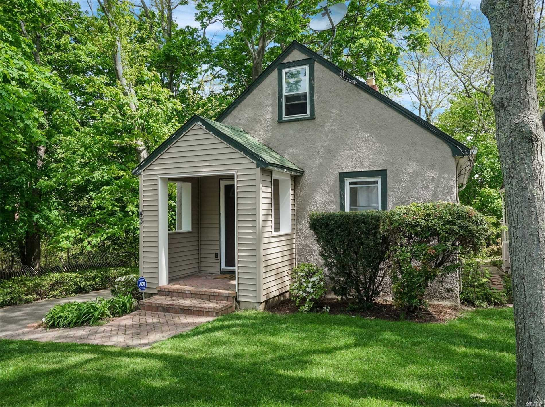Lots New in this 2 Story Cape with Front Portico. Cathedral Mstr Suite w/Palladium Window and Woodland Views. New Floors, Burner & Oil Tank, Appliances and Newer Anderson Windows. Brick Patio, Walk to Long Island Sound Beach. Slight Winter Water View. LOW, LOW Taxes. Just Move In. Listing Agent/Agency makes No Warranties or Representations.