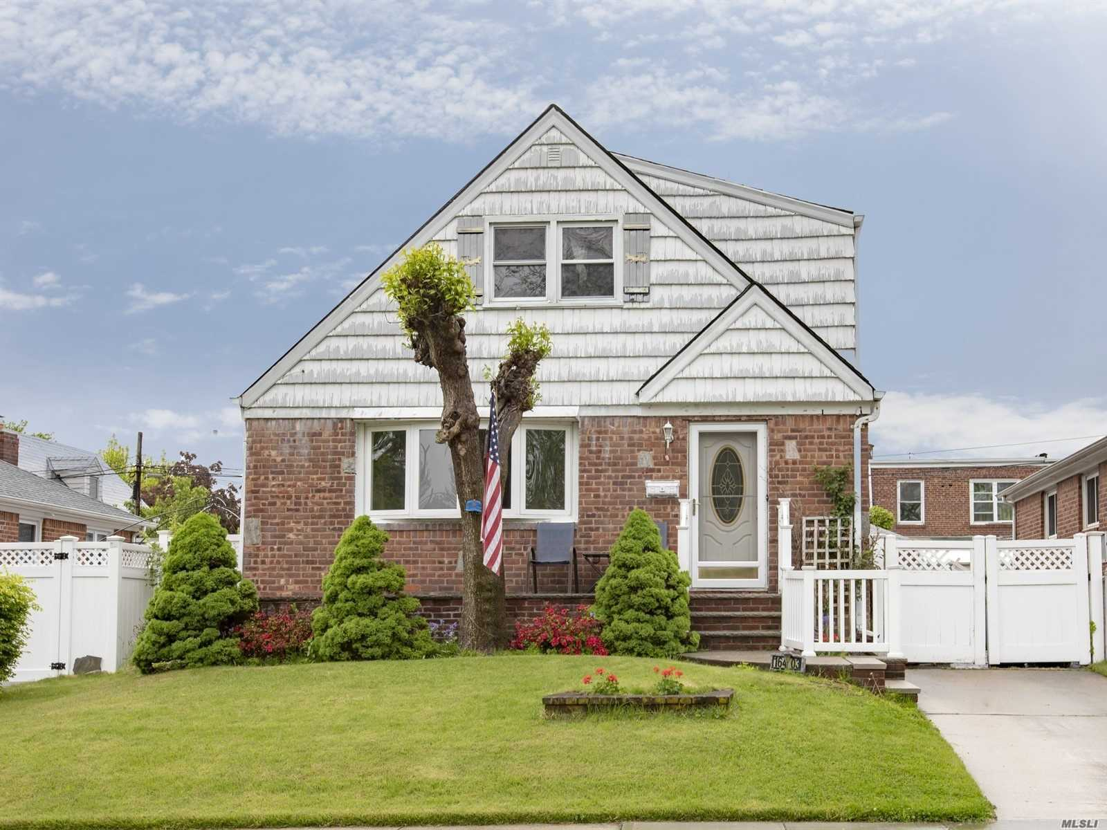 Expanded Cape Cod on tree lined street in beautiful North Flushing. Welcoming porch great for summer night gatherings. Curb appeal for sure! Four large bedrooms not seen too often. Updated bathrooms and a newly renovated expansive lower level. This charmer is in the best location ever. Public transportation, shopping, highways all within close proximity. This is a feel good house waiting for a new story...
