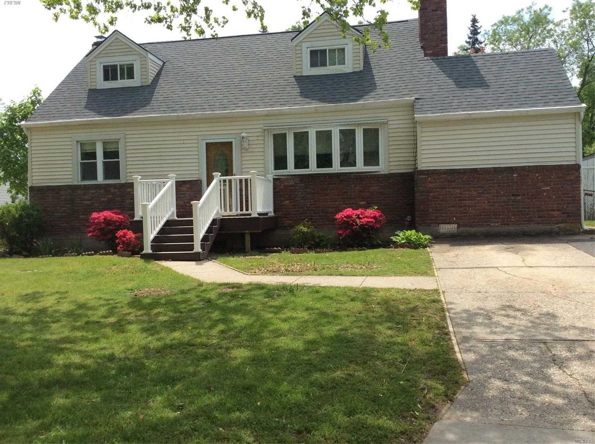 This well maintained home features, open floor plan , new carpet and flooring throughout . newer kitchen, stainless steel appliances, duel brick fireplace, newer bath, entire home freshly painted , cedar closet, central air condition, new roof , furnace, full finished basement with outside entry, french doors to new deck, fenced park like grounds & much more . Middle Country schools .
