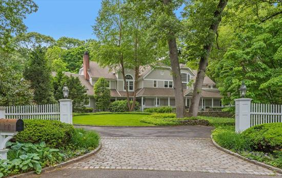 Center Hall Colonial expanded & rebuilt with the finest in detail & design. Dramatic two story entry introduces generous principal rooms where family and friends will gather. Highlights include a European-like master suite, paneled library, sun room, indoor sports court and home theater.  Award winning gardens enhance the picturesq two acres setting. Covered wrap around porch, pool, spa and tennis. Equestrian Paradise with easy access to the trails & preserve. Four-car garage. Jericho SD.