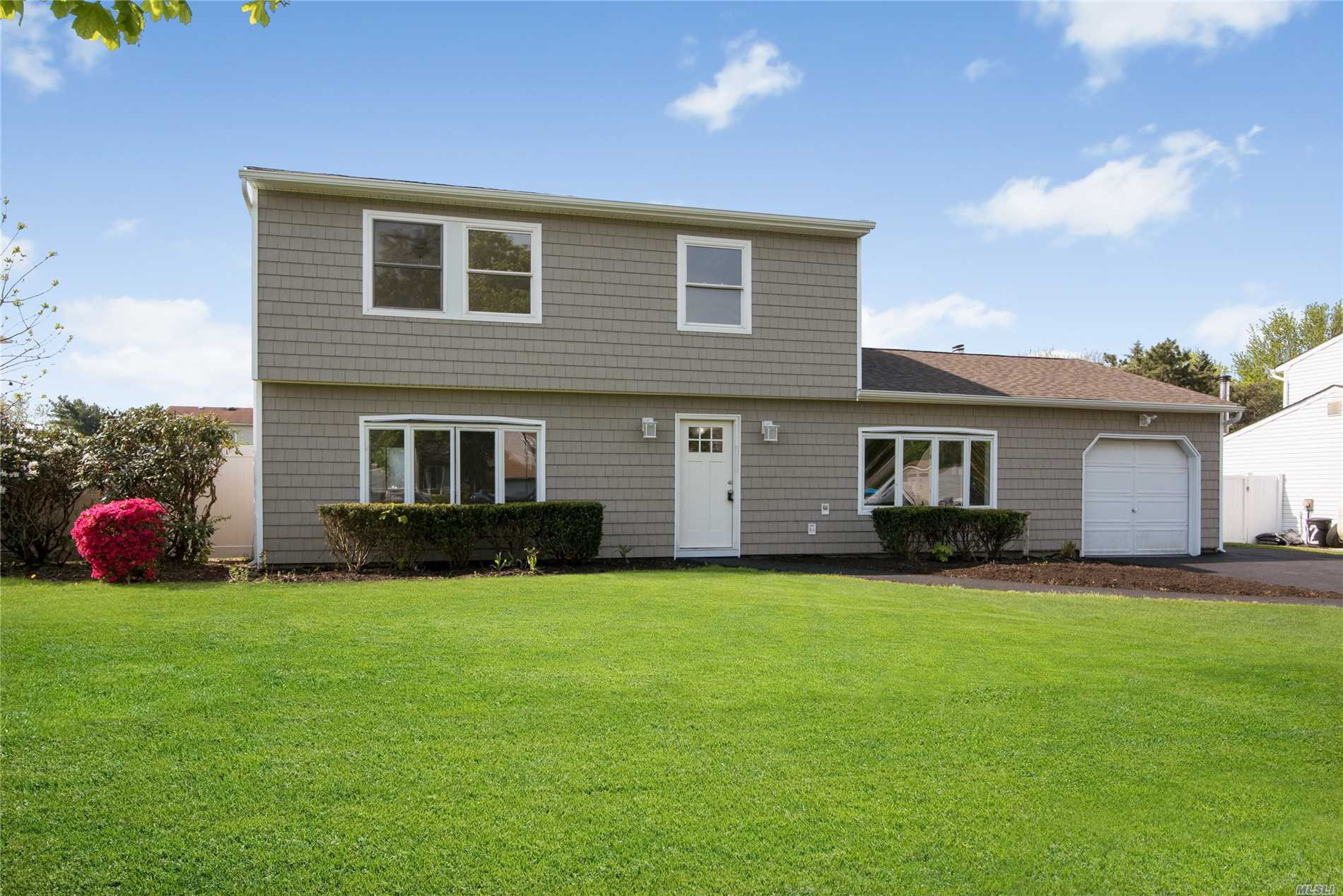 Beautiful two story colonial home. NEWLY RENOVATED. Open floor plan. Enjoy a spacious backyard with enough room to install an in-ground pool if desired. This home features an open kitchen with lots of cabinet space facing living room. Enjoy cooking while entertaining guest. Newly installed roof. New boiler. New Hardwood floors throughout the downstairs living areas. One car garage and a private driveway to complete the home experience.