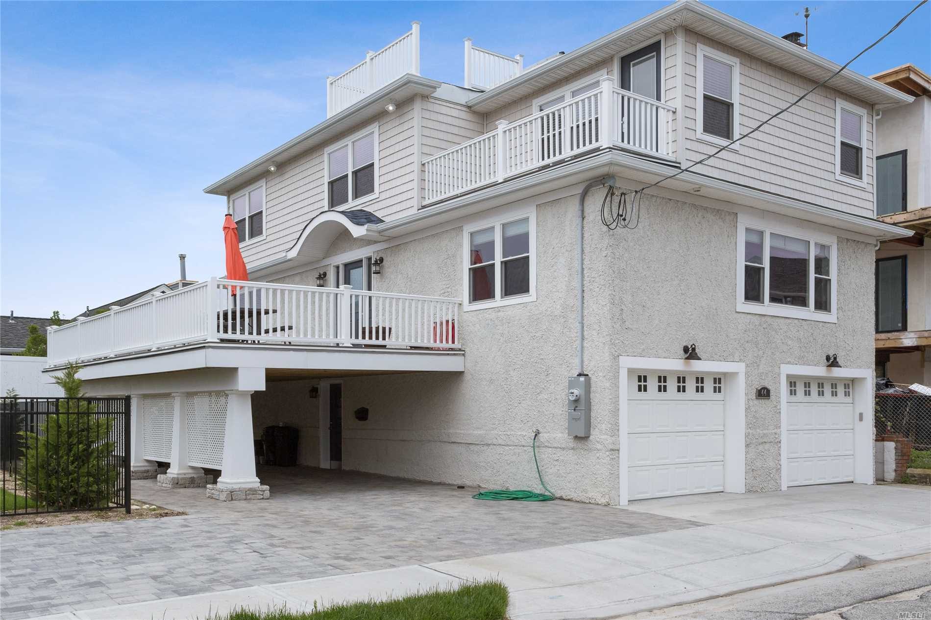 Beautiful, Newly Built Single Family Residence Located In The Quiet, Private Beach Community of Lido Dunes. Completely Brand New Inside and Out! Ocean Views From The Side Deck, Very Large Side Yard Open To Tons Of Sunlight! Come Enjoy The Summer Hamptons Style Without The Commute!