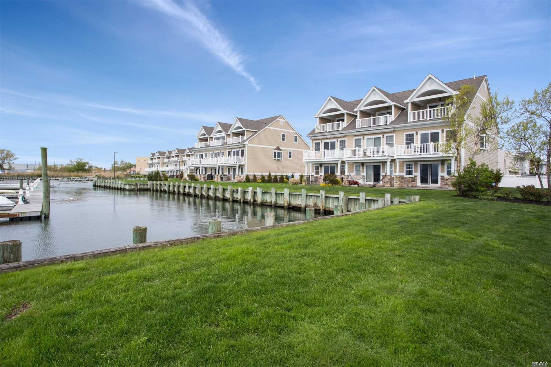 Stunning Bayfront Townhouses Feat Outstanding Views, Assigned Boat Slip, Pvt Entrance& Gar, Wood & Stone Floors, Tumble & Glass Tiles. 2 Gas Fireplaces, Viking Appliance, Marvin Windows & 3 Decks, Master Suite