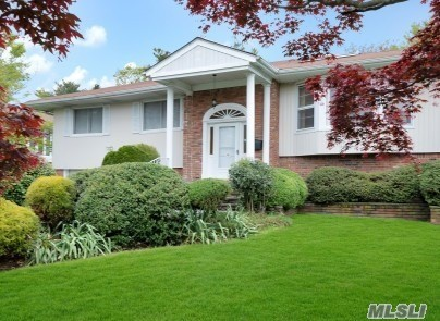 Prime Location in Manhasset Hills. Bright Open Floor Plan Offers Living Rm, Formal Dining Rm, Oversized EIK. 4 Bed, 3 Bath Office/Bed, Family Rm W/Fireplace, Lush Green Large Private Backyard, 2 Skylights, Gas Heat, Cac, 2 Car Garage, Close To Highways, Hospitals, LIRR & Shopping. Herricks Schools. Grievance Has Been Filed To Reduce Taxes.