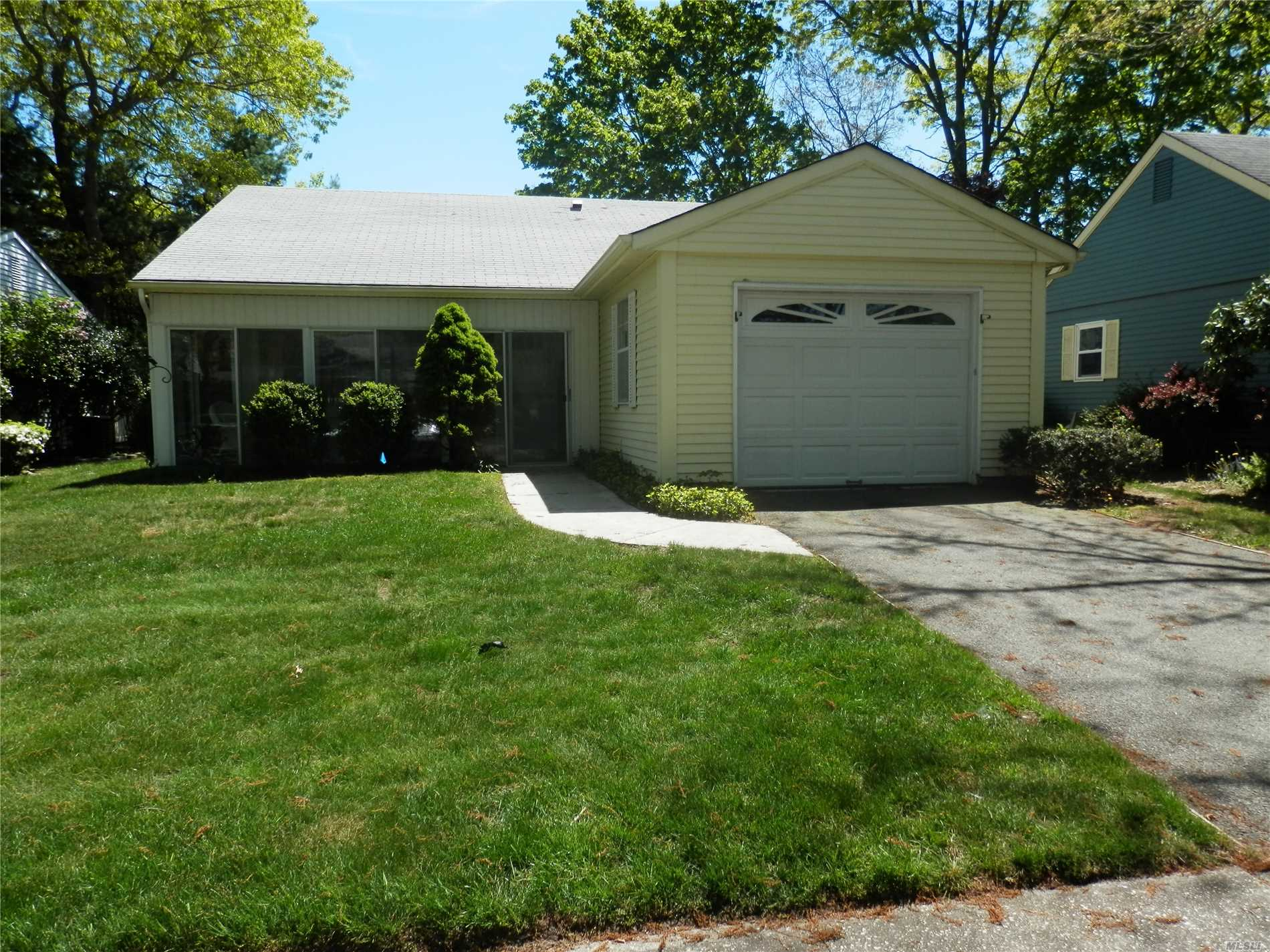 Lovely sunny home in beautiful Leisure Knoll. Closed in front porch and lovely patio to enjoy. Skylight in Kitchen. Enlarged garage with drop down stairs for attic storage. Gated security in evening. Bus service for residents. Many amenities to enjoy. Make this home your own.