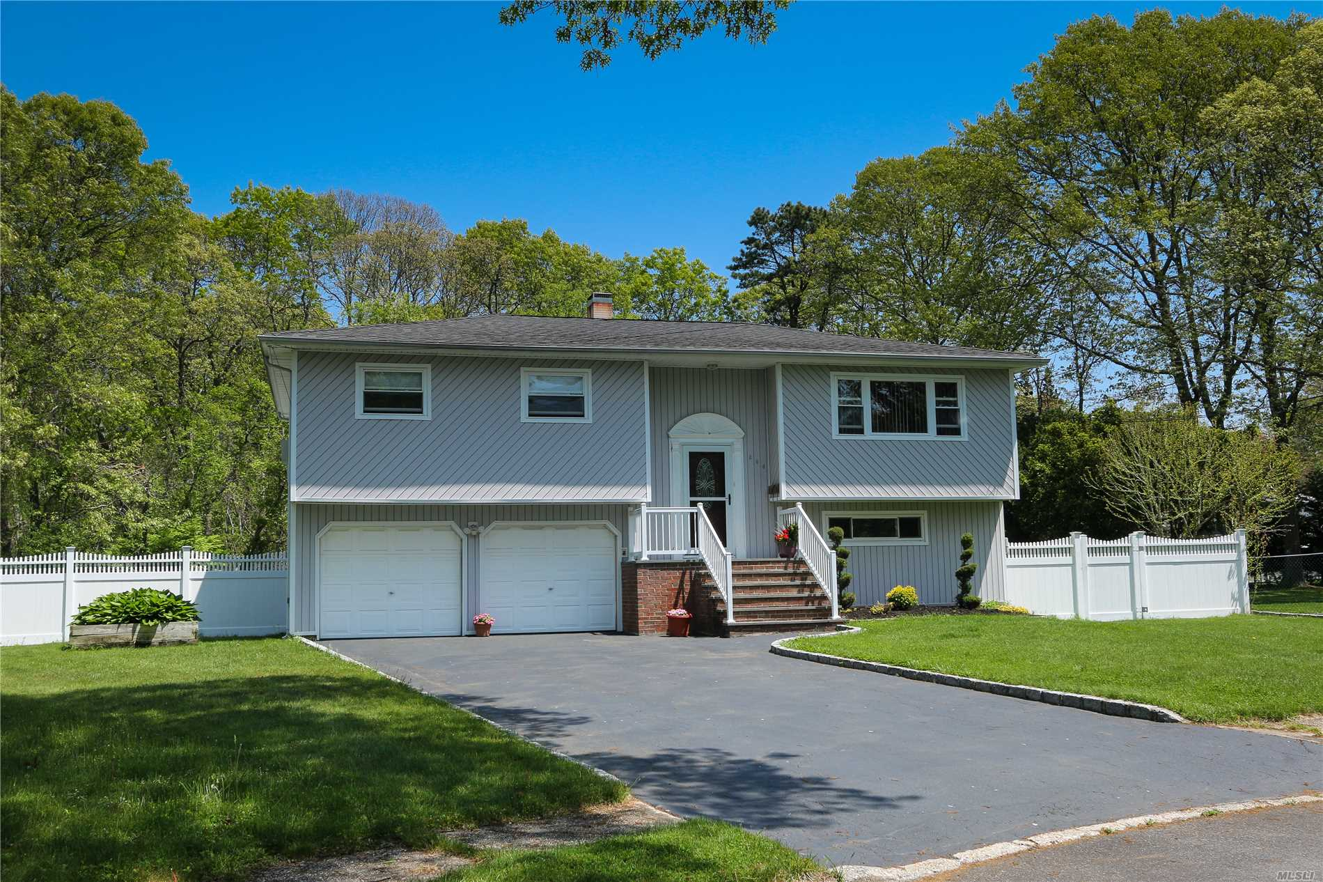 Move in Ready Home in Sayville School District. Nestled on a quiet Cul de Sac, this home over looks a quiet nature preserve. The large deck off of the Kitchen expands your living space for outdoor entertaining. The lovely In Ground Pool has steel walls and a 2 years old Liner. Yard is fenced in for privacy.