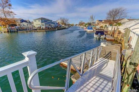Live Beyond The Beach in This Turn Key, 2189 Sq Ft 4/5 Br Home On Deep Wide Canal Mins.To Open Bay In Prestigious Shores Loc. Open Flr Plan That Boast A Quality Custom Eik W Granite & SS Appl*Wine Cooler*Crown Moldngs &Highhats Throughout*Cac(Down Only)*Igs*2 New Baths*Updated Elec* LR W Cath Ceiling& Sliders To Trec Deck*Elec Awning*49.9 Ft Plastic Bulk, Dock, Ramp & Boat Lift, (Fits 51 Ft Boat)*Pot M/D W Prop Permit*Bike To Private Beach* Flood only $649YR. Hurry, This home Says , Buy me!