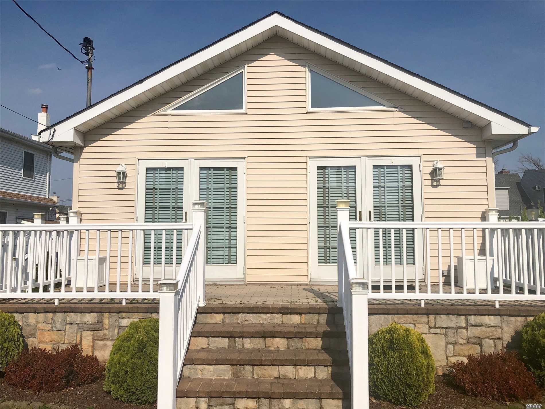 updated mint honme steps to private beach and bay, home has all amenities with porch, deck, yard.