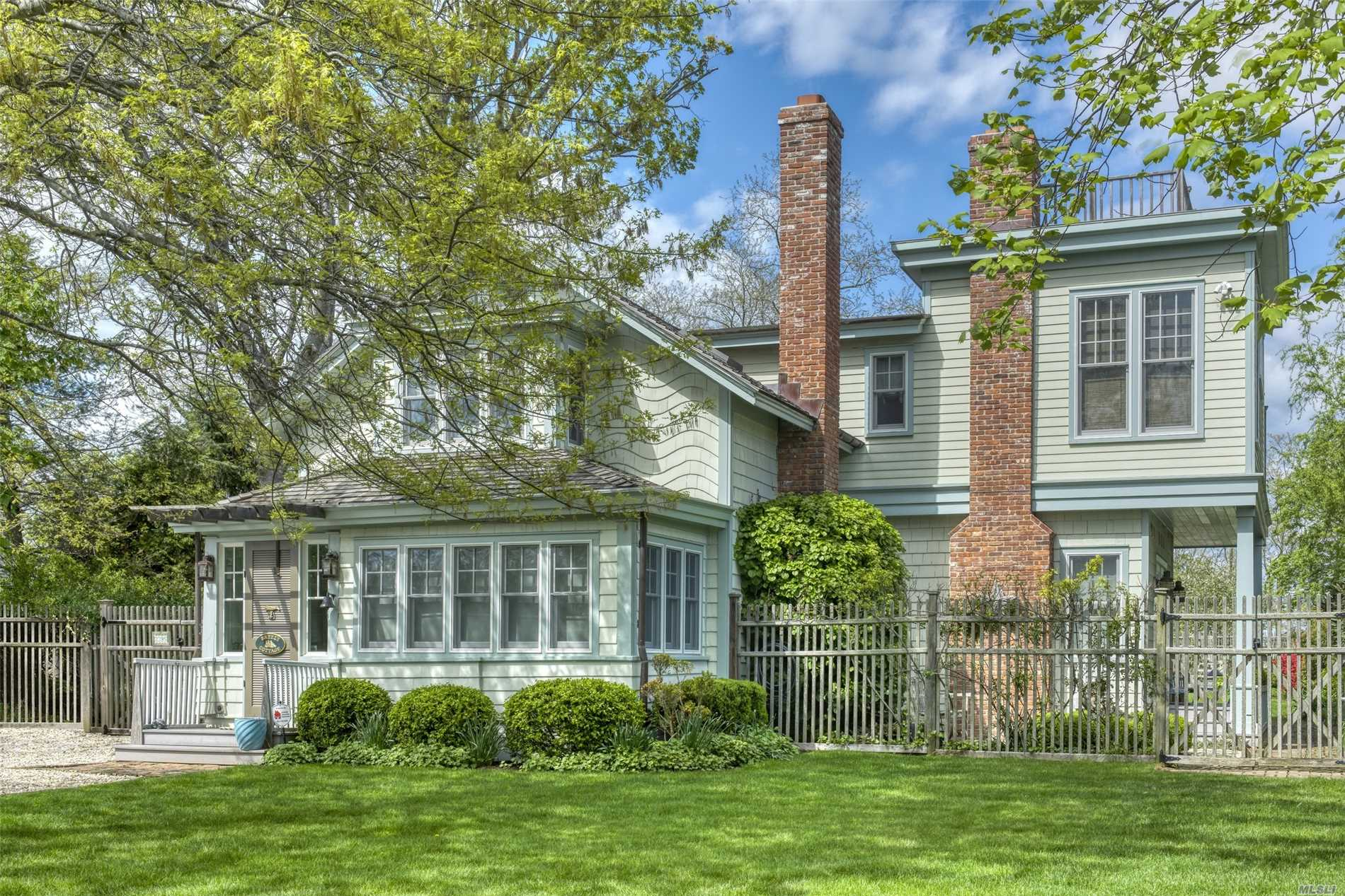 Exquisitely restored and renovated 19th C home, located on coveted King St. in Orient Village with open field views. Main house has gourmet kitchen, 2 fireplaces, original hardwood floors, sunroom, CAC, upper balcony. Antique converted, restored barn guest house has 2 bedrooms & large common space. Gunite heated swimming pool, separate garage/studio, large deck with pergola, outdoor shower, potting station & so much more.