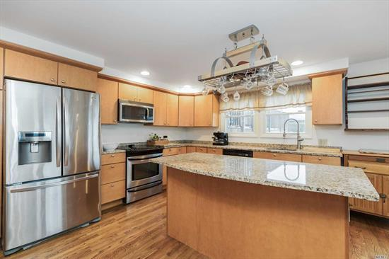 Mint and Expanded, Custom 2700 sq ft 4 Br & 4 Full Bth Split in the desirable Ocean Lea area. Beautiful waterviews. HW floors, 5 sensored skylights, CAC, new heating, Gym/den w/hot tub, Master Br w/Bth walk in closet & private deck, wrap around decking on 2nd floor off brs, Large & open Granite EIK w/center Isle, 2 door gar which fits 4 cars tandem. 2 Prvt Driveways. Large multi-car driveway, Motorized Iron Fencing for back drwy. Not in flood Zone. Near LIRR. Taxes being grieved by seller!