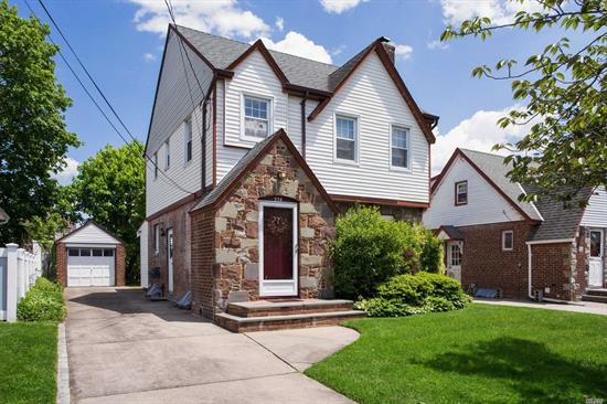 3 Bedroom Tudor Style Colonial, Eat in Kitchen, Formal Dining Room, Family Rm.,       Prime Location, Close to Stores,  Convenient to LIRR 35min to NYC