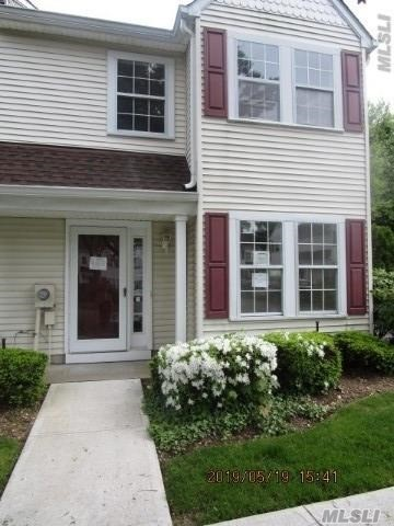 Great Location - End Unit - Semi-Detached - Large Living Room leads to patio via sliding glass doors.