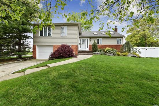 Clean & Meticulous Split Level Home Professionally Landscaped Set On Oversized Property Located In Massapequa Park. This Home Features Hardwood Floors, Recessed Lighting, Cac, Eik W/Vaulted Ceilings, Custom Cabinetry, SS Appls, Granite Counter Tops, 3 Skylights, Living Rm, Den W/Laundry Area, Master W/Full Bath, 2 Additional Bedrooms, Full Bath, Full Basement W/Utilities, Fully Fenced (PVC) Private Yard, In-Ground Sprinklers, 1 Car Garage. Close To Schools, Shopping, Restaurants & Transportation.