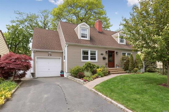 Totally Redone Expanded Cape in Prime Location. New Kitchen with Professional Stainless Steel Appliances, New Bathrooms, Expanded Den with Radiant Heated Flooring, New Roof, New Siding, New Flooring throughout. Finished Basement with tons of space. Too much to list, If you're looking for home in this area, you found the one, don't delay