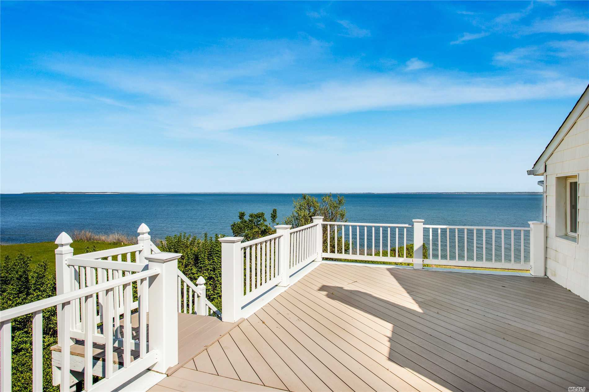 Classic, Pristine Peconic Bayfront Property with 127.72 of Bulkhead. Steps down to your Private Beachfront. Lavish on the Expansive & Lush Waterside Lawn, or Relax on the Topside Deck, while Enjoying the Magnificent Peconic Bay Views. Home boasts (4) beds, (3) baths, inclusive of Master En Suite, (1) Bed on First Floor. Formal Dining & Living Room w/Fireplace & added Sitting Area, to Soak up the Sun. Kitchen is Open Plan with Breakfast Bar, Opening into Den. Solar Panels on Roof is a Plus!