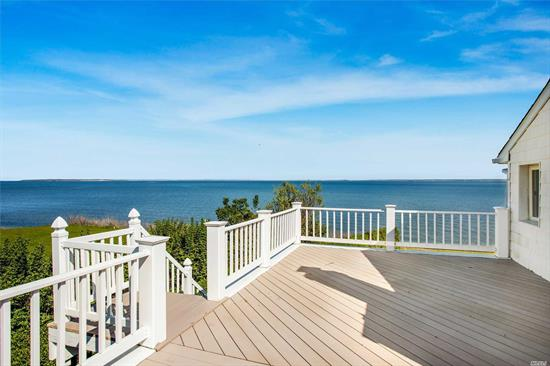 Pristine Peconic Bayfront Gem! You've found your secluded slice of heaven, in this 4 bed/3 bath home, nestled at end of a private road, off of Peconic Bay Blvd. With 127' plus of bulkhead & mere steps down to your own private sandy beachfront, the ultimate waterfront North Shore lifestyle is yours to enjoy. Savor breathtaking open views of the Peconic Bay from your expansive & lush waterside lawn. Perfect for summer parties, or relax on the topside deck feeling as if your in a world of your own!