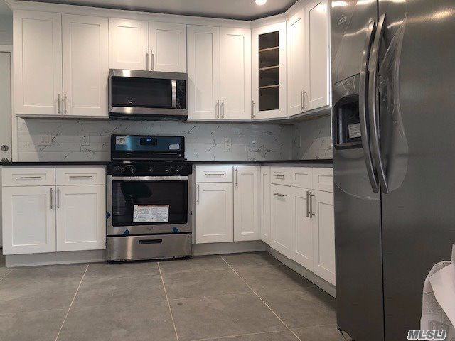 Renovated Huge One Family, Perfect For Extended Family, Located In The Heart Of Elmont - Close To The Major Highways And Transportation, Offering 4 Bedrooms, 2 Full Bath, Full Basement - Hard Wood Floors, Stainless Steel Appliances And Much More.