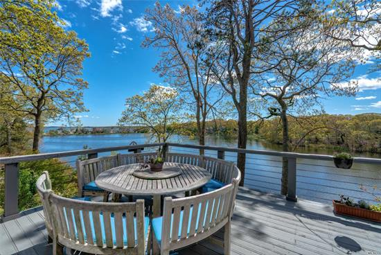Stylish & Spacious. This renovated Waterfront Home on Marion Lake offers 4 Ensuites w/Expansive Views of the Lake & Beyond. Each Level Has Open Floor Plan W/Fireplace & Sliders to Waterside Decks. Large, Light-Filled Entertainment Spaces. Property is Beautifully Landscaped. There is a Dock on the Lake & Deeded Beach at the End of Truman's Path. A Nature Lover's Paradise.