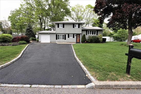 BEAUTIFULLY UPDATED AND EXPANDED 3 BEDROOMS 2BTH SPACIOUS SPLIT COLONIAL WITH 2 OFFICES (OR MUSIC ROOM ), PARTLY FINISHED BASEMENT, 1.5 CAR GARAGE. BEAUTIFUL KITCHEN W/GRANITE COUNTERS, SS APPLIANCES, GLASS BACKSPLASH, HW FLOORS THROUGHOUT MAIN HOUSE AND BEDROOMS, JACUZZI BTH TUB, 200 AMP ELECTRIC, NEW CESSPOOL, 5/6 CAR EXTENDED DRIVEWAY, PVC FENCE AND MORE ! GREAT CURB APPEAL AND BEAUTIFUL PROPERTY.WALKING DISTANCE TO CORAM ELEMENTARY SCHOOL .