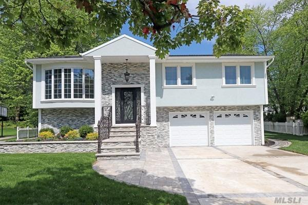 Better than new custom designed high ranch in Manhasset Hills. Renovated in 2019. This home features 4 bedrooms 3 full bathrooms. Gourmet eat in kitchen open to living room and family room. Designer bathrooms. Oversized private property. Room for in ground pool in backyard.