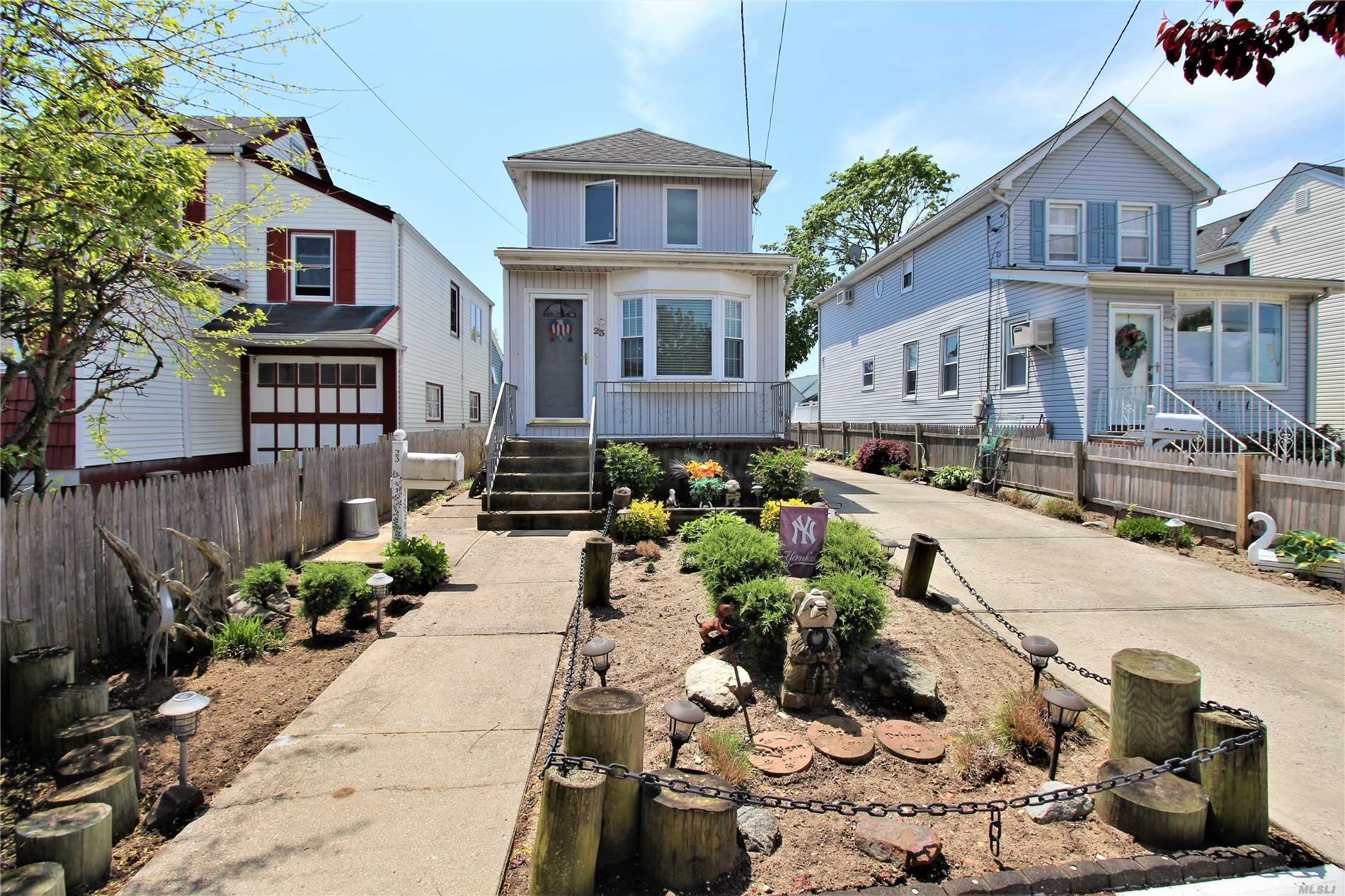 Super Charming 3 Bedroom 2 Bath Colonial on 125 Foot Deep Property. Features Include; Formal Living Room & Dining Room, Updated Eat In Kitchen w/Peninsula, Pantry Closet & Door To Private Yard. 3 Nice Bedrooms, Gas Cooking & Navien Heating System. Oak Hardwood Floors, Sold Wood Doors & Moldings. 1.5 Car Garage, Attic & More. Low Taxes & Low Flood Insurance.